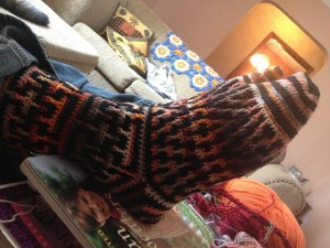 my son's gargantuan size 14 feet, cozy and warm, in his favourite socks.  01/2013